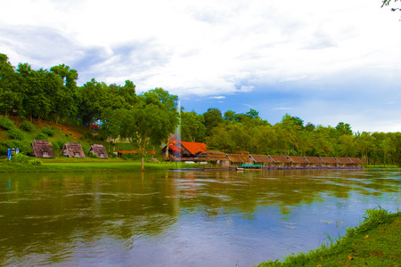 boathouse: Riverside boathouse along the river in Thailand