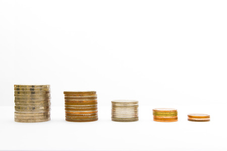 Stacks of saving coins on white background  photo