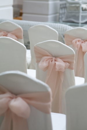 a meeting with a view to marriage: wedding chairs elegantly decorated