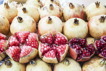 Close-up shot of some ripe and juicy pomegranates