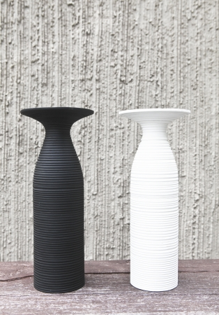 twoWhite and black vases photo