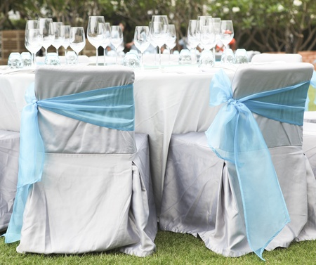 gorgeous wedding chair and table setting for fine dining at outdoors Stock Photo - 16323967