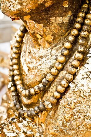 Details of golden Buddha statue photo