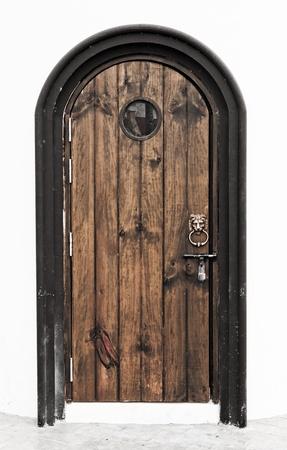 lion headed door knocker on painted wooden door Stock Photo - 16322561