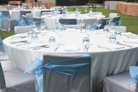 gorgeous wedding chair and table setting for fine dining at outdoors Stock Photo