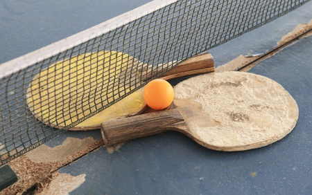 Old Equipment for table tennis - racket, ball, table photo
