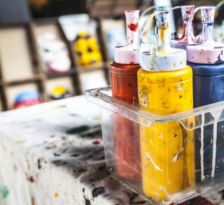 Colorful paints bottles photo