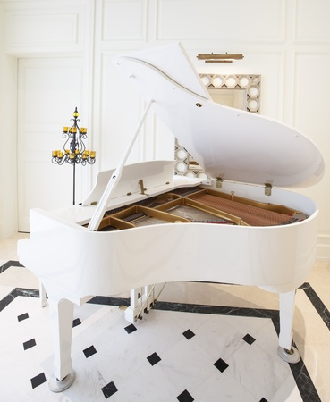 White piano in white room photo