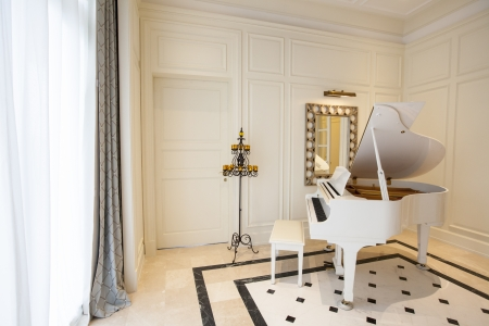 White piano in white room Stock Photo