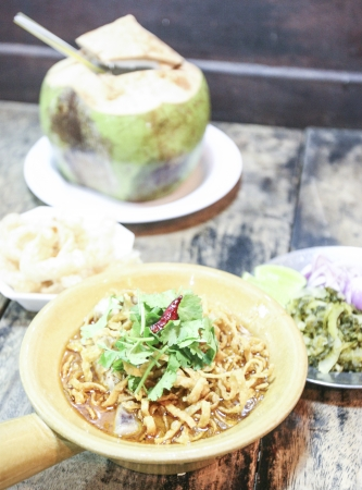 favorite soup: Thai rice noodles with chicken curry soup  Khao Soi Gai  - The original recipes   favorite traditional food of Northern in Thailand  Stock Photo