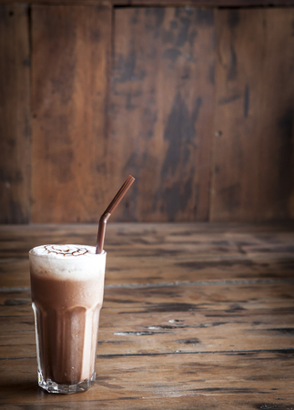 Iced chocolate on wood background photo