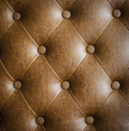 brown leather sofa: Closeup trama di vendemmia divano in pelle marrone per lo sfondo
