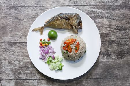 Fried Mackerel and rice on a plate photo