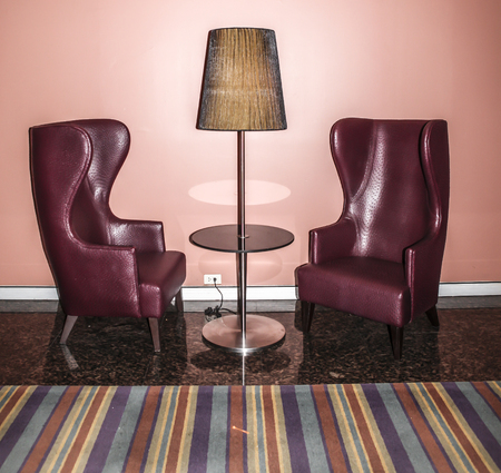 Modern Red Chairs On A Shiny Black Stone Floor Stock Photo, Picture ...
