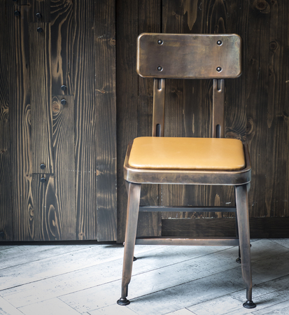 chair in an empty room with wooden photo