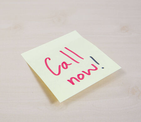 important phone call: A yellow square sticky note with the words Call Me written on it.
