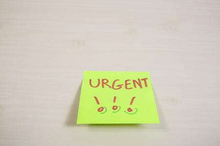 Urgent word on sticky note  photo