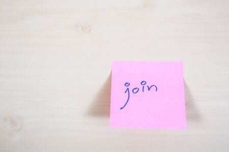 paper note: Join on yellow paper note Stock Photo