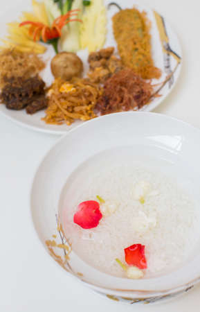 side dishes: Rice in ice water and side dishes.