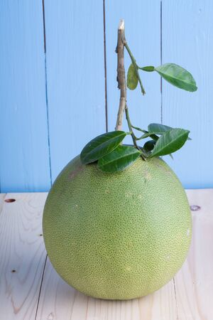 pummelo: Green Pomelo - on the wooden background