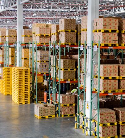 stacker: High rack stacker forklift truck in distribution warehouse