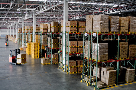 shipping supplies: forklift in the large modern warehouse