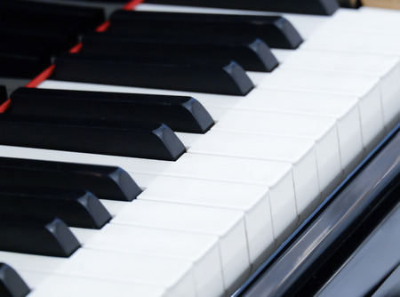 acoustically: Selective focus point on Old vintage piano keys