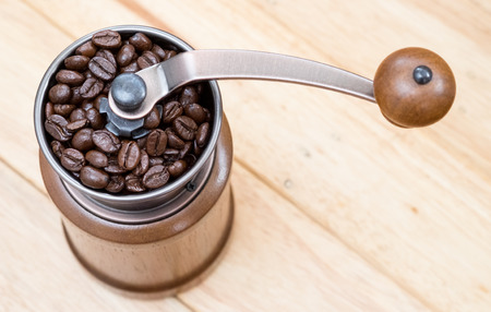 Close up of coffee beans in coffee grinder Stock Photo