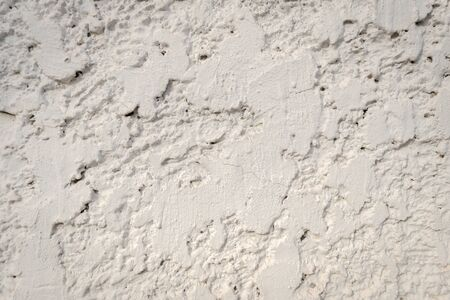 pitted: white crude concrete wall background Stock Photo