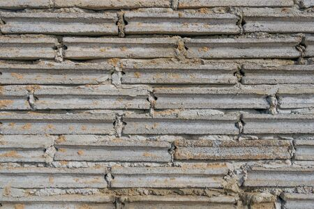 cell block: crude brick and sand  background texture Stock Photo