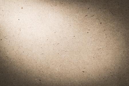 hardboard: plywood hardboard background with light from corner