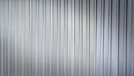 industrail: grunge Aluminum corrugated Ribbed background texture with light from corner Stock Photo
