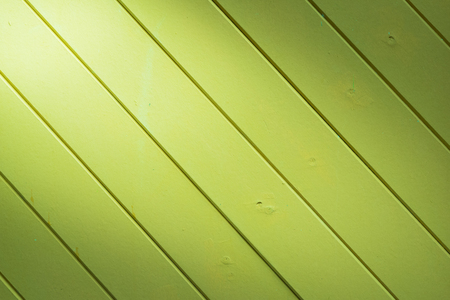 lopsided: beautiful diagonal  green wood background texture with light from corner Stock Photo