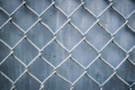 enclose: steel wire mesh fence wall background