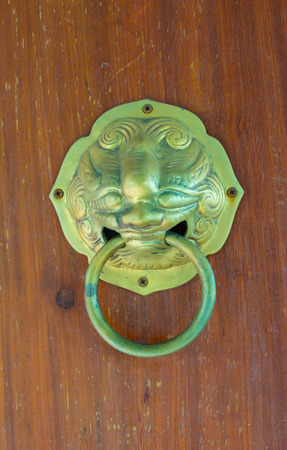 chinise lion head knocker on Traditional asian door