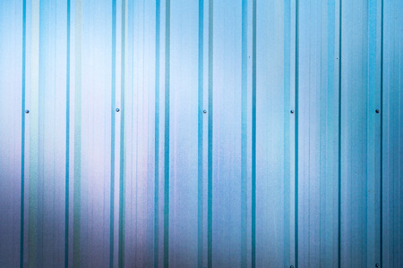 beautiful blue zinc wall background with light from corner