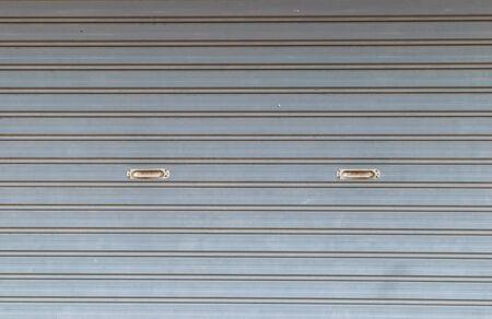 shutter door: illuminated grunge metallic roller auto shutter door