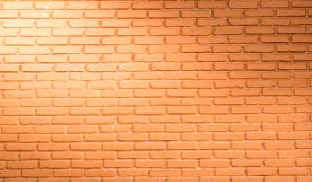 red brick wall background with light from corner