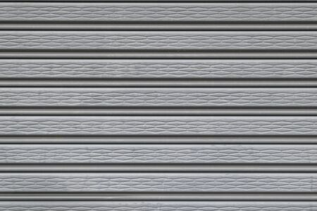metal wall: illuminated grunge metallic roller auto shutter door background