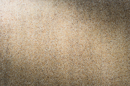sand stone wall background texture with light from corner Фото со стока
