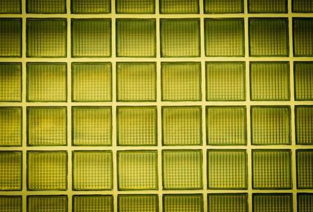 glass block: Vignette yellow glass block wall background Stock Photo