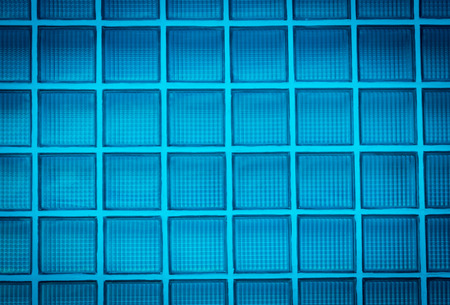 Vignette blue glass block wall background