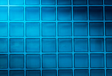 blue glass block wall background with lighting from corner