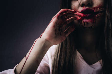 Zombie women death  ghost standing with blood, darkness background, horror halloween festival concept Stock Photo