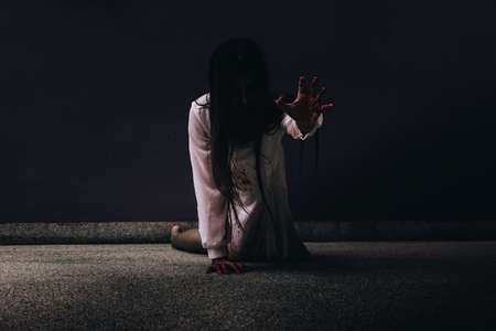 diabolic: Zombie women death ghost with blood, darkness background, horror halloween festival concept