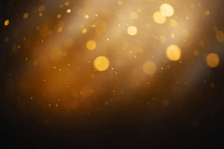 Bokeh circle abstract gold, black and white effect with flow and glitter star snow celebration for christmas night party light pattern background texture wallpaper.