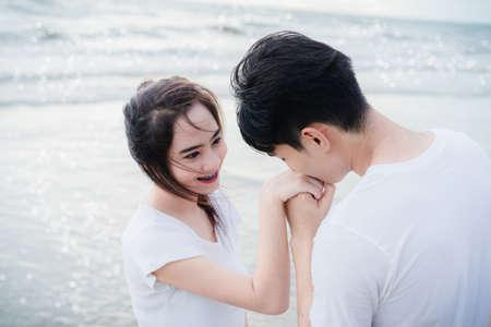 Close up Young man kissing hand girl at beach