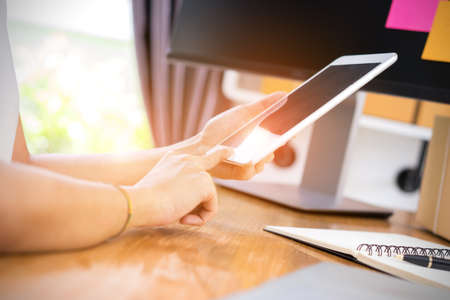 post it: Closeup,Young girl freelancer business private working at home office using tablet with note and packaging delivery online market on purchase orders to customer