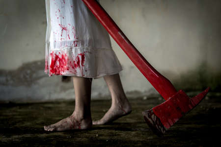 Zombie woman or ghost holding axe with blood walking in house of ruin nightmare, horror of scary fear on hell is monster devil in halloween festival. Stock Photo