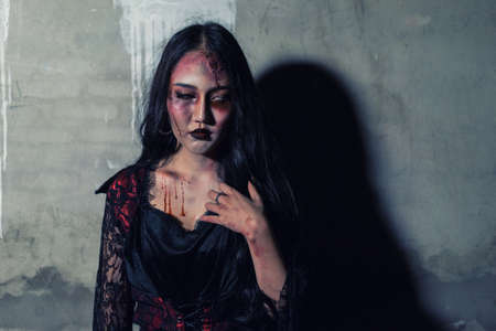 Zombie women death or witch the ghost with blood skin is screaming darkness and nightmare background, horror of scary fear on hell is monster devil girl in halloween festival concept